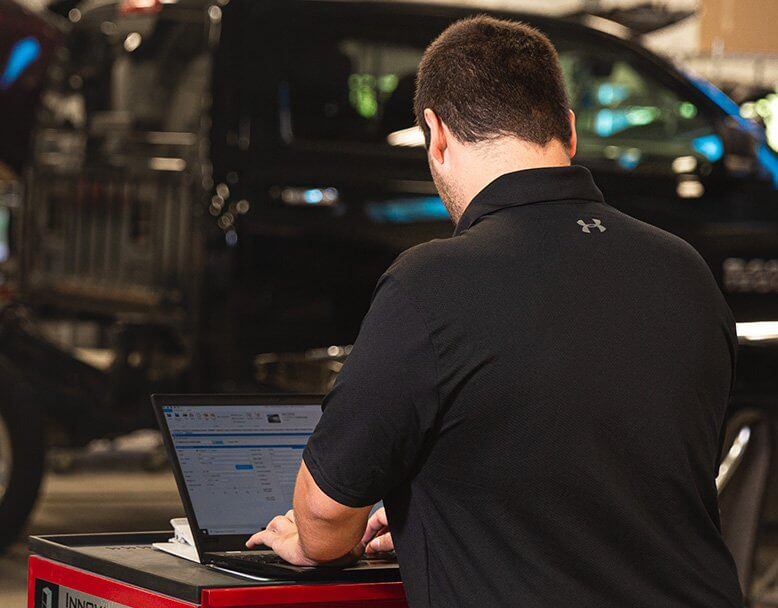 Employee working on the computer in the garage